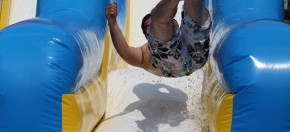 A big kid jumping down the slide